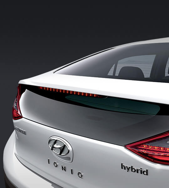 Integrated rear spoiler